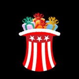 Patriotic Santa Claus cap with gifts. Winter Hat Uncle Sam for g Royalty Free Stock Photos