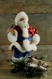 Patriotic Santa Claus holding the American flag royalty free stock photography