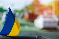 Ukrainian flag on glass inside the car. Patriotic sign Ukrainian flag on glass inside the car, ukraine, national, blue, symbol, yellow, country, patriotism stock images