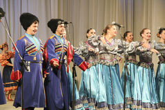 Patriotic singing. Folk ensemble Kazachya Volnitsa in Rostov-on-Don, Russia. October 2014. Beautiful ethnic dance and patriotic songs Stock Photo