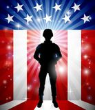 Patriotic Soldier American Flag Background. A patriotic soldier in front of an American flag background Royalty Free Stock Image