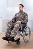 Patriotic soldier sitting on wheel chair Stock Photography