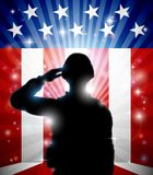 Soldier Saluting American Flag Background. A patriotic soldier standing saluting in front of an American flag background Stock Images