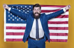The patriotic spirit. Patriotic man holding american flag on independence day. Bearded businessman being patriotic for stock photography