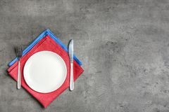 Patriotic table setting with traditional USA colors on grey background, flat lay. Space for text stock images