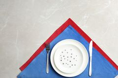 Patriotic table setting with traditional USA colors on grey background, flat lay. Space for text royalty free stock images
