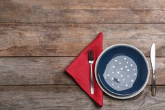 Patriotic table setting with traditional USA colors on wooden background, flat lay. Space for text stock photos