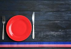 Patriotic table setting with traditional USA colors on wooden background, flat lay. Space for text royalty free stock photo