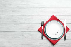 Patriotic table setting with traditional USA colors on wooden background, top view. Space for text stock photography
