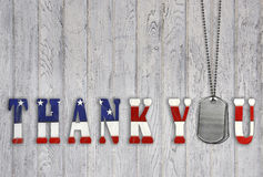 Patriotic thank you for military. American flag thank you with military dog tags on weathered barn wood Royalty Free Stock Photo