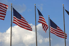 Patriotic United States Flags White Clouds Blue Sky Royalty Free Stock Photography