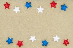 Patriotic USA background on the sandy beach. Patriotic USA background with stars decorations on the sandy beach stock image