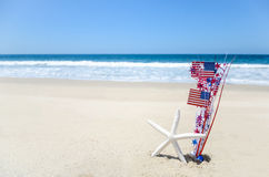 Patriotic USA background with starfish on the sandy beach. Patriotic USA background with starfish amd decorations on the sandy beach stock photography
