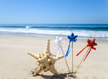 Patriotic USA background with starfish on the sandy beach. Patriotic USA background with starfish decorations on the sandy beach stock photography