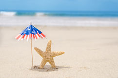 Patriotic USA background with starfishes. And decorations on the sandy beach stock image