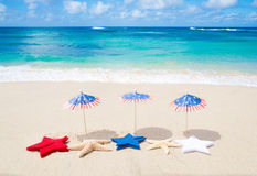 Patriotic USA background with starfishes. And decorations on the sandy beach royalty free stock image