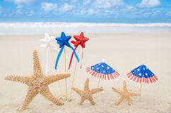 Patriotic USA background with starfishes. And decorations on the sandy beach stock photography