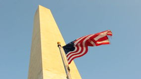 Patriotic Washington Monument. Patriotic Flag at Washington Monument. In front of the blue sky stock video