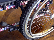 Patriotic Wheels. United States flag colors on disabled veteran's wheelchair Royalty Free Stock Images