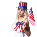 Patriotic Woman with American Flag isolated on white. Independence day. Beautiful Blonde Girl Royalty Free Stock Photo