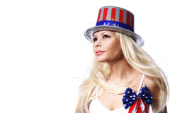 Patriotic  Woman with American Flag print on Hat. And Bow isolated on white. Independence day. Beautiful Blonde Girl Stock Photos