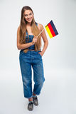Patriotic woman holding germany flag Royalty Free Stock Photos