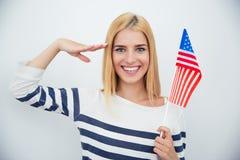 Patriotic woman holding USA flag stock image