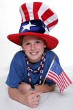 Patriotic Young Girl With Young Patriotic Girl In Laying Position With Flag Royalty Free Stock Images