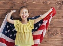 Patriotisk ferie och lycklig unge Arkivbild