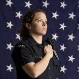 patriotisk kvinnlig polis Arkivfoton