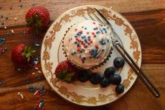 Patriotiska muffin för Juli 4th beröm Royaltyfri Foto