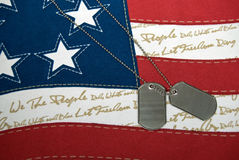 Military dog tags on American flag Royalty Free Stock Photography