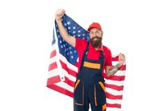 Patriotism and national pride are openly expressed. Bearded man holding national flag of the USA on white background. Happy workman celebrating national royalty free stock image