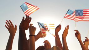 Patriots waving flags of America. stock footage