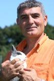 Patrizio Oliva com um coelho imagens de stock
