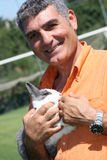 Patrizio Oliva with a rabbit royalty free stock image