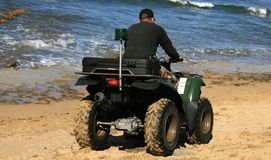 On patrol. A police on patrol at the beach Stock Photography