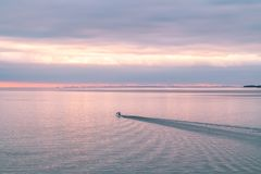 Patrol boat in the Finnish Gulf at sunset royalty free stock image