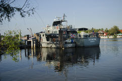 Patrol boat of marine police or water polices. Stop rest and waiting for working in night time at Mae klong river on April 12, 2017 in Samut Songkhram, Thailand Stock Photos