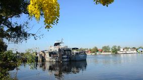 Patrol boat of marine police or water polices stop rest and waiting for working in night time at Mae klong river. SAMUT SONGKHRAM, THAILAND - APRIL 12 : Patrol stock video