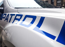 A patrol car. A partial view of a patrol car zoomed in on the word & x22;Patrol& x22 Stock Photo