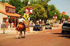 On patrol, Ft Worth Stockyards. A horseback mounted security officer patrols the streets of the Fort Worth Stockyards stock photo