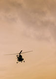 The patrol helicopter flying in the sky Royalty Free Stock Image