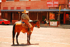 On Patrol. A mounted police office patrols the Fort Worth Stockyards in Texas royalty free stock photo