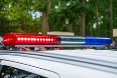 Patrol police car with red and blue lights on the street. Patrolling the city.  royalty free stock image