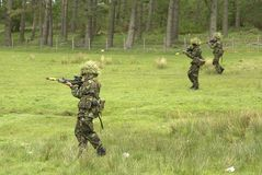 Patrolling. 3 female UK soldiers on patrol stock images