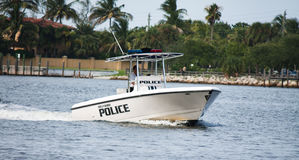 Patrolling the beach. Police officer on his boat unit patrolling the beach and waterway of Hollywood, Florida Royalty Free Stock Image