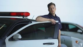 Patrolman getting out from car and walking into police station, end of shift. Stock footage stock video footage
