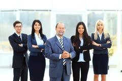 Patron et équipe d'affaires Photos stock