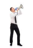 Patron fâché d'homme d'affaires criant avec un mégaphone Photographie stock